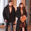 "Jamie Dorman as Christian Grey and Dakota Johnson as Ana Steele on the set of ""Fifty Shades of Grey"""